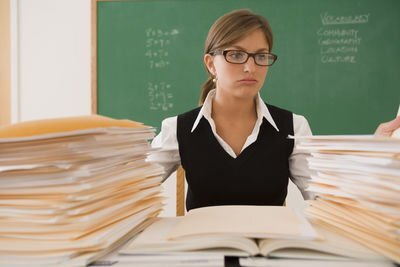 Teacher with papers