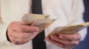 depositphotos_55076389-businessman-counting-50-euro-banknotes